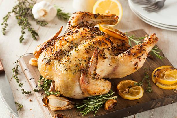 homemade lemon and herb whole chicken - geheel stockfoto's en -beelden