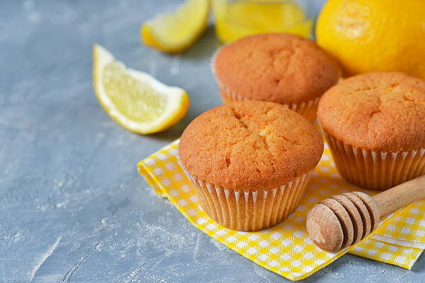 homemade, lemon muffins with honey and mint - quarkmuffins stock-fotos und bilder