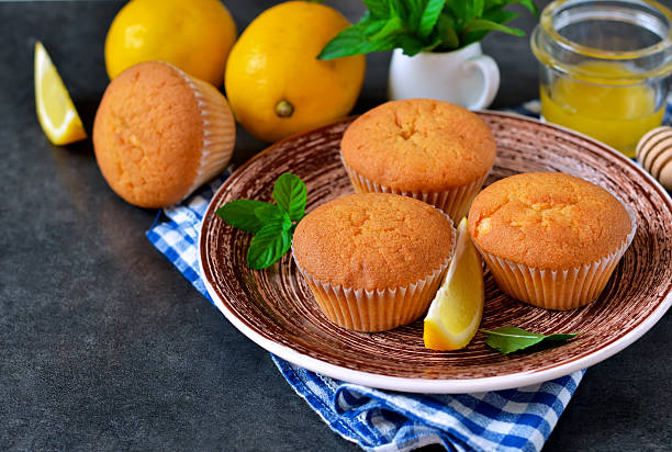 homemade, lemon muffins with honey and mint . - quarkmuffins stock-fotos und bilder