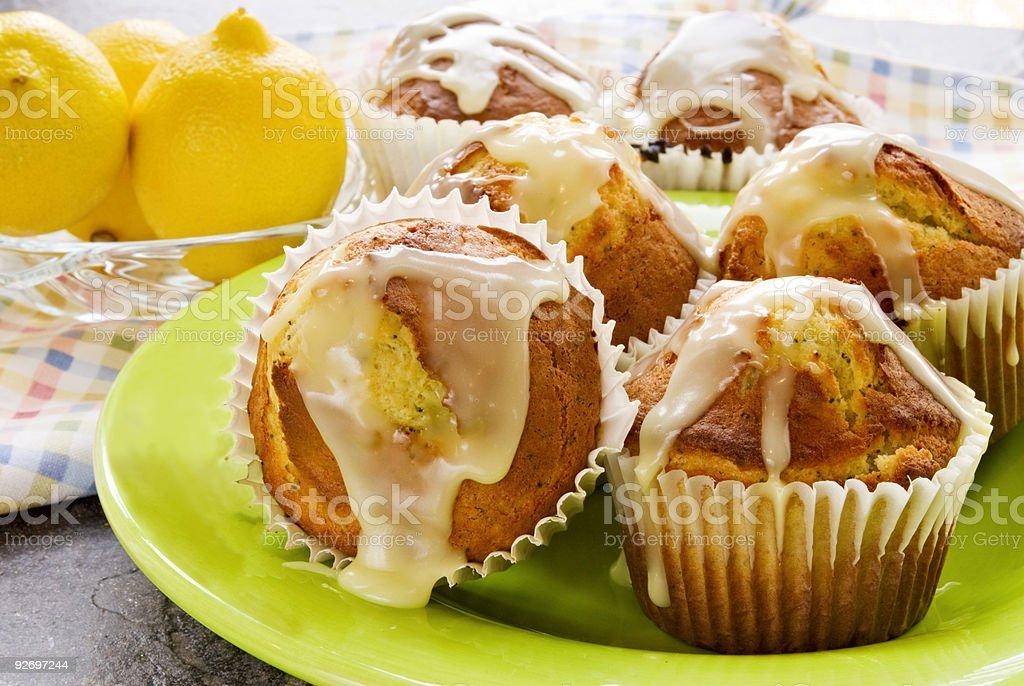 Homemade lemon poppy seed glazed jumbo sized muffins stock photo