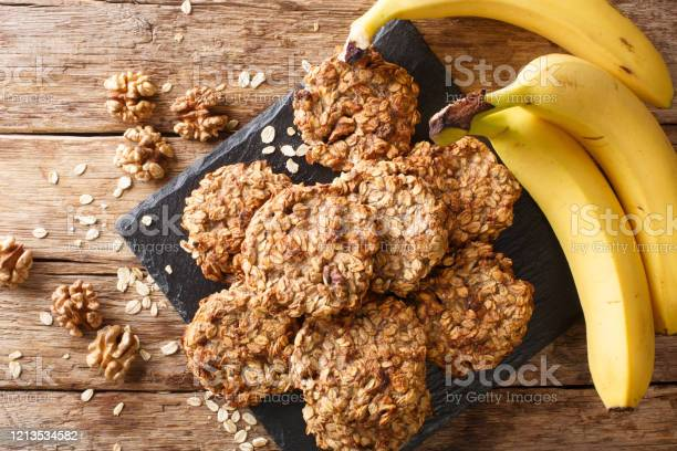 Homemade Lowcalorie Banana Cookies With Oatmeal And Walnuts Closeup On A Slate Board Horizontal Top View Stock Photo - Download Image Now