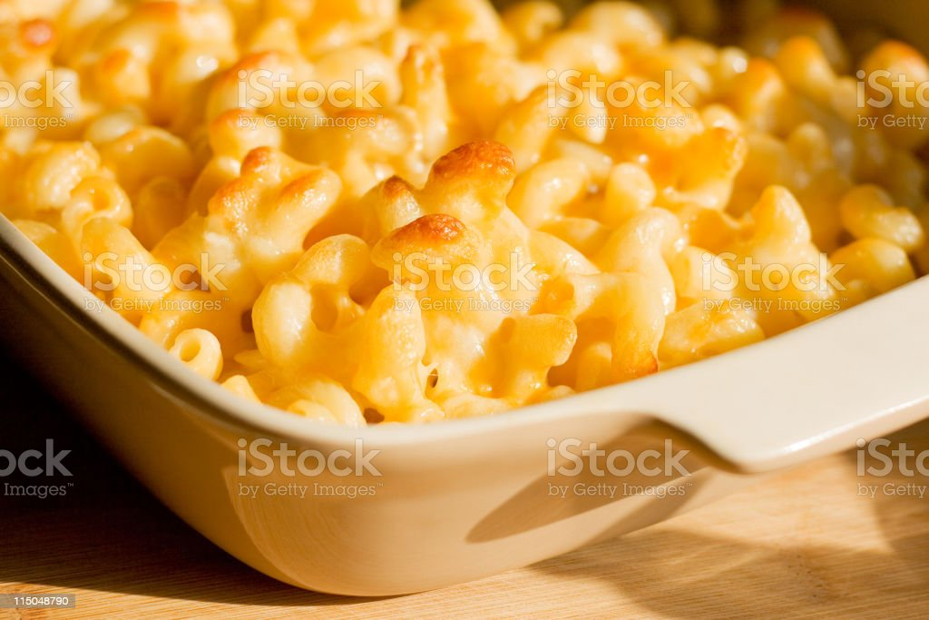 Homemade Macaroni and Cheese Casserole in Tan Glass Dish royalty-free stock photo