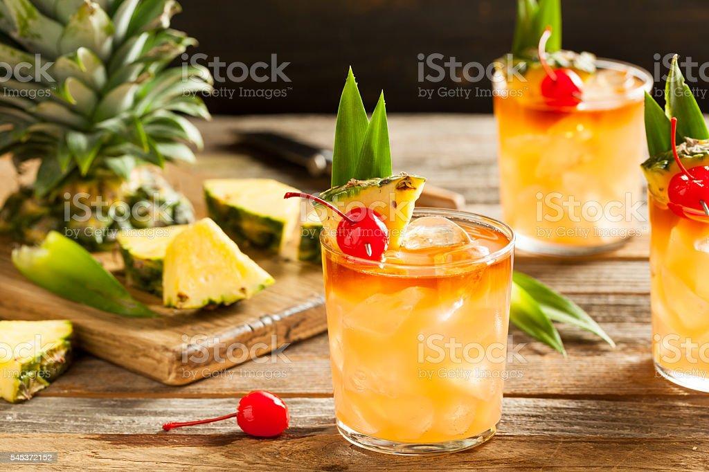 Homemade Mai Tai Cocktail Homemade Mai Tai Cocktail with Pineapple Cherry and Rum Adult Stock Photo