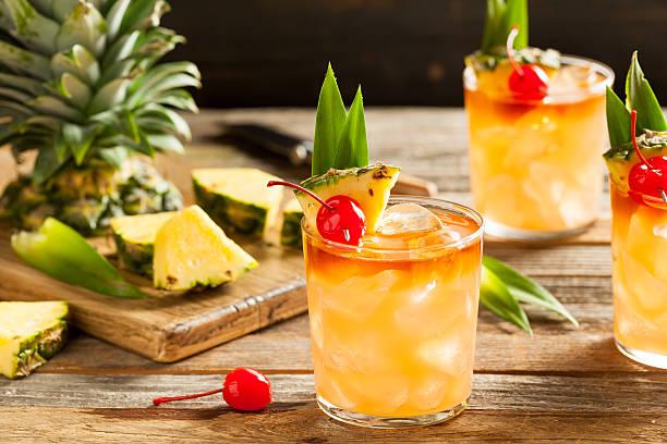 homemade mai tai cocktail - caribbean food stock photos and pictures