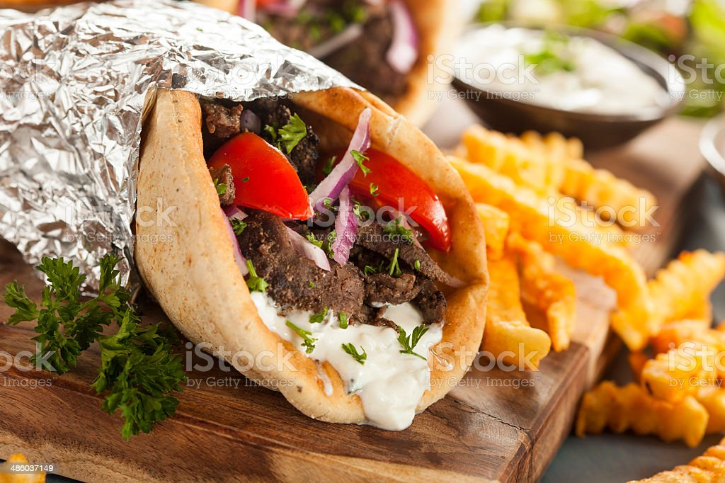 Homemade Meat Gyro with French Fries stock photo