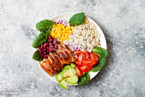 istock Homemade Mexican chicken burrito bowl with rice, beans, corn, tomato, avocado, spinach. Taco salad lunch bowl 912134046