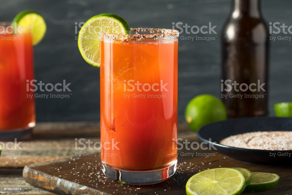 Homemade Michelada with Beer and Tomato Juice stock photo
