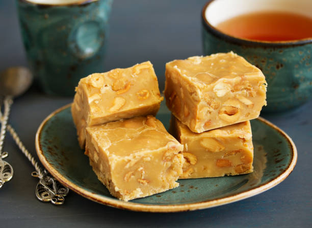Homemade milk fudge with roasted peanuts. stock photo