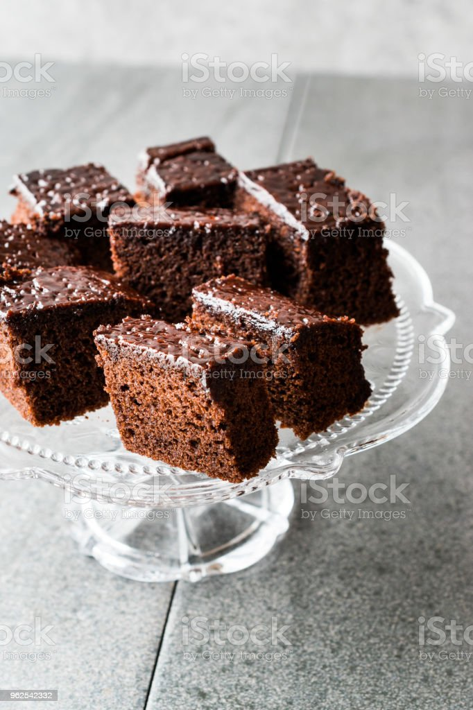 Homemade Moist Chocolate Sponge Cake Brownie Pieces in Vintage Glass Dessert Stand. - Royalty-free Antique Stock Photo