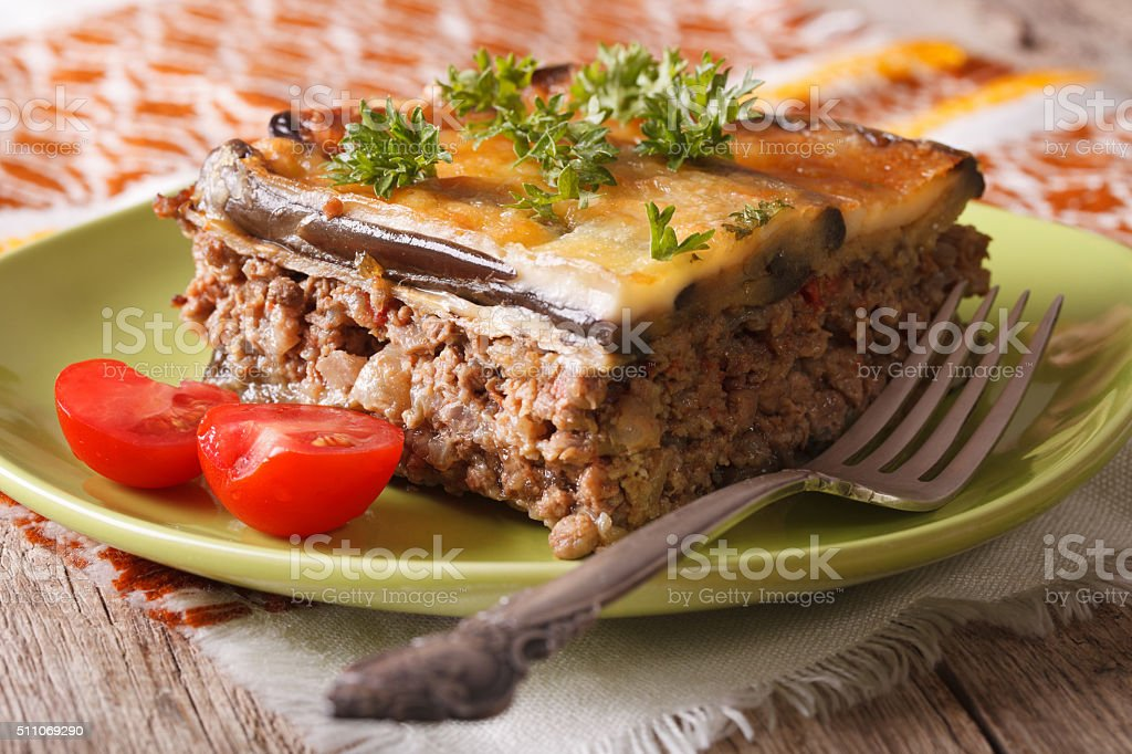 Homemade moussaka on the green plate close-up. horizontal stock photo