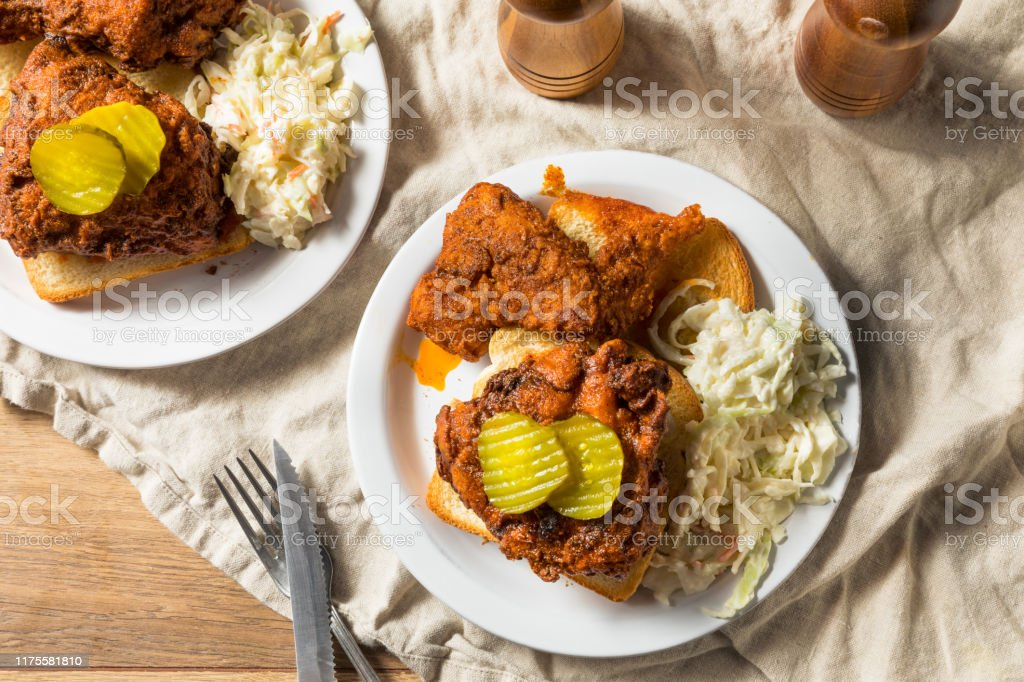 Homemade Nashville Hot Chicken Homemade Nashville Hot Chicken with Bread and PIckles American Culture Stock Photo