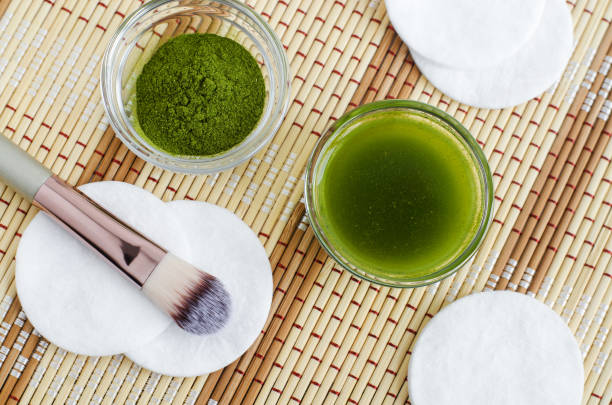 Homemade natural face toner (infusion, tincture) with matcha powder. Diy green tea cosmetics recipe. Top view, copy space Homemade natural face toner (infusion, tincture) with matcha powder. Diy green tea cosmetics recipe. Top view, copy space greentea stock pictures, royalty-free photos & images