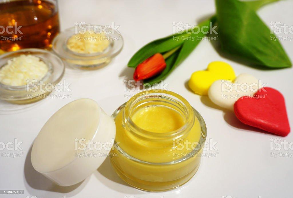 Homemade natural moisturizing honey skin cream - Stock image .