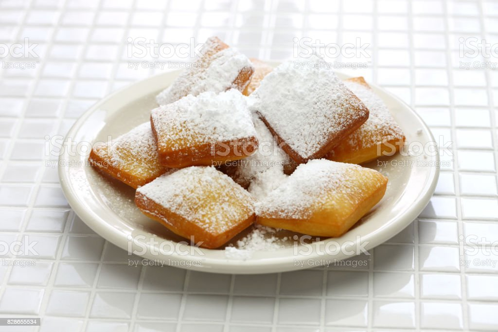homemade new orleans beignet donuts with plenty of powdered sugar stock photo
