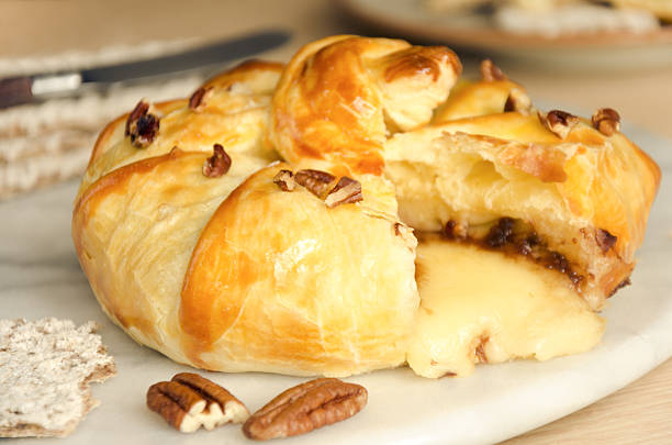 homemade nutty baked brie - baked brie stock photos and pictures
