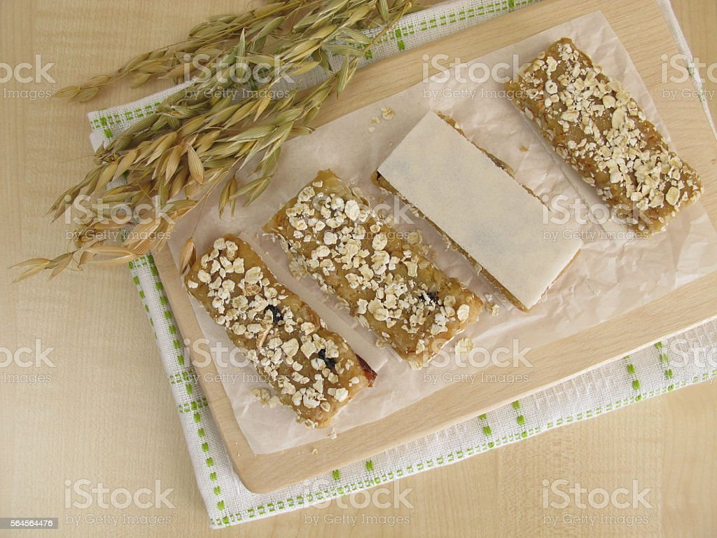Homemade oat bars with nuts and raisins stock photo
