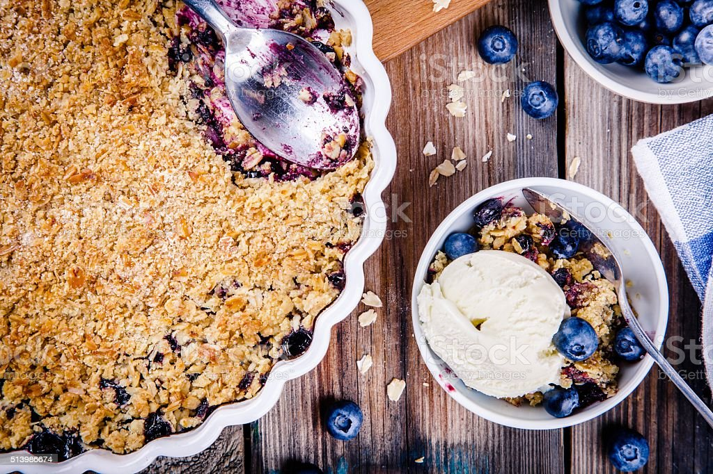 homemade oatmeal blueberry crumble with ice cream stock photo