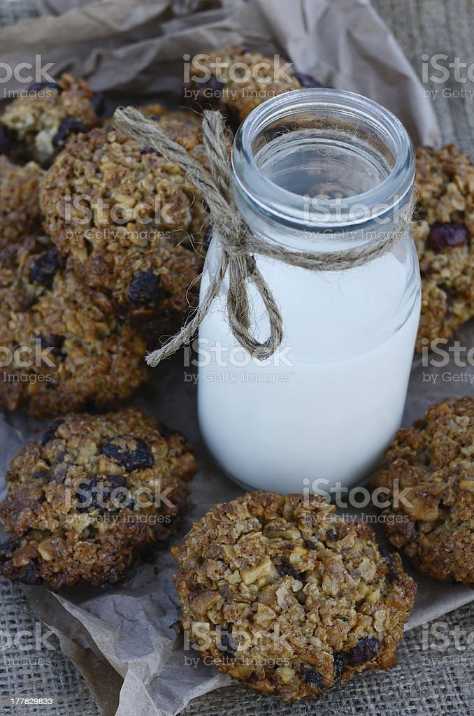 Homemade oatmeal cookies and bottle of milk royalty-free stock photo