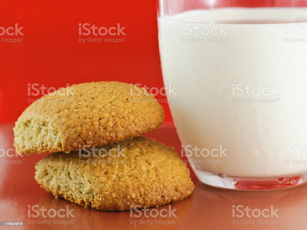 Homemade oatmeal cookies and glass cup of milk royalty-free stock photo