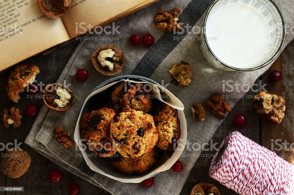 Homemade oatmeal cookies and glass of milk for cozy breakfast stock photo