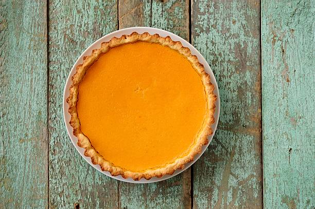 homemade oldfashioned open round pumpkin pie on old painted wood - pumpkin pie 個照片及圖片檔