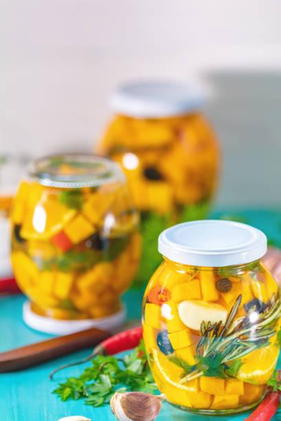 Homemade orange cut pumpkin pickles stock photo