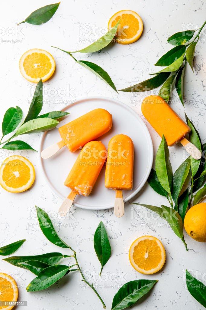 Homemade Orange Ice Cream On Stick White Background With