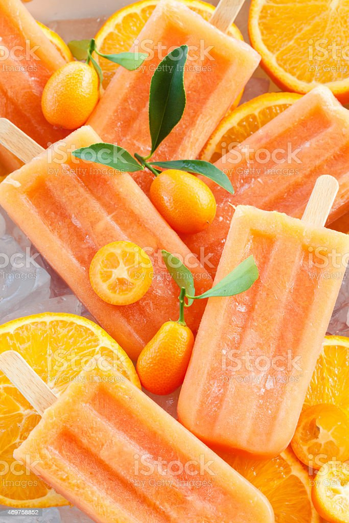 Homemade orange popsicles stock photo