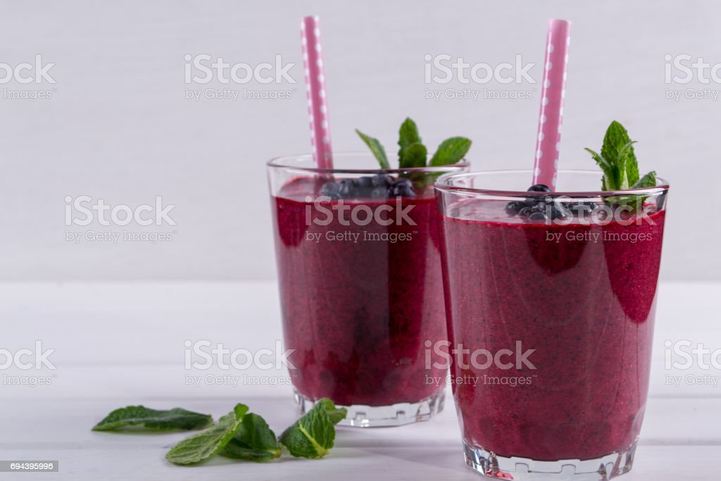 Homemade organic blueberry smoothy  with berries and mint stock photo