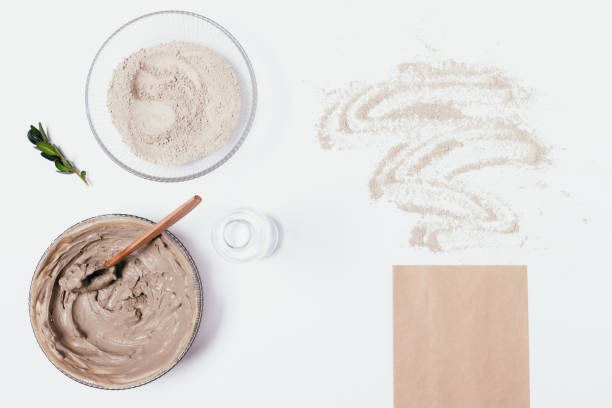 Homemade organic clay face mask in bowl stock photo