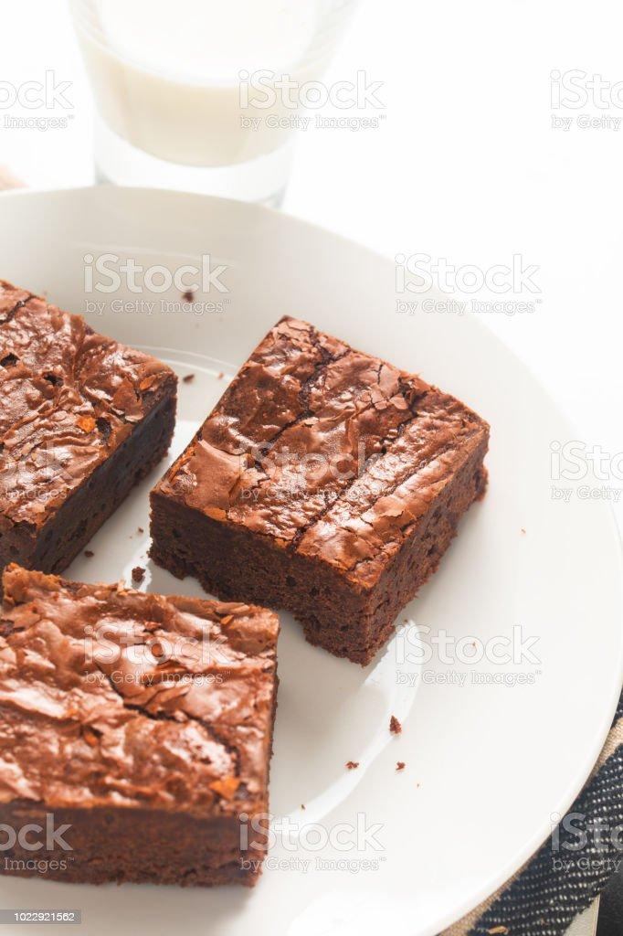 Homemade organic fudge and crispy brownies on white plate stock photo