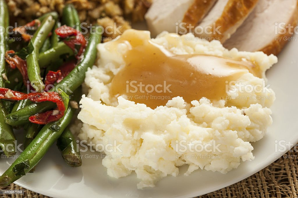 Homemade Organic Mashed Potatoes with Gravy stock photo