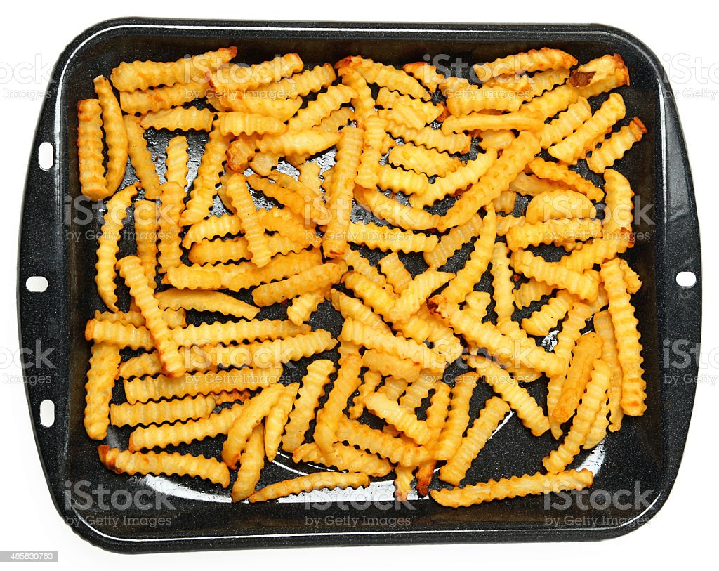 Homemade Oven Baked Crinkle Fries in Pan stock photo