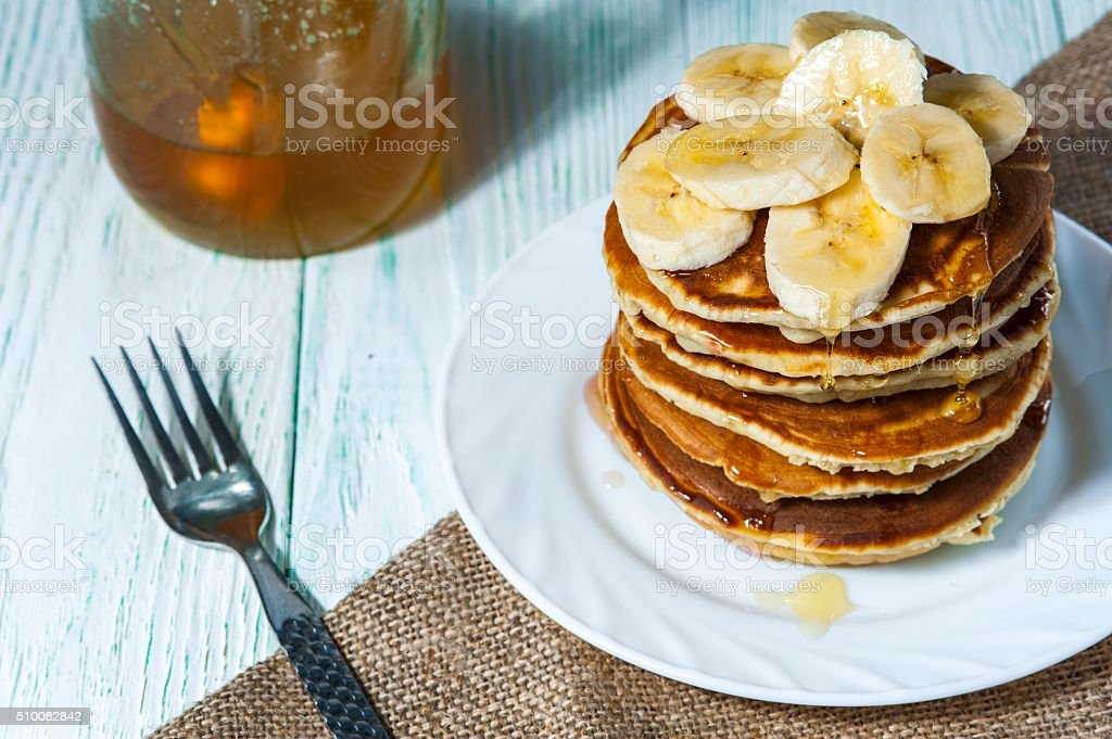 Homemade pancakes with banana slices stock photo
