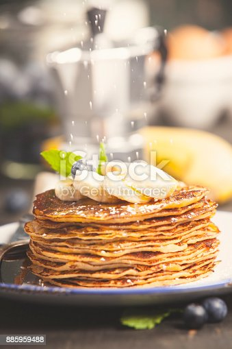 istock Homemade pancakes with fresh bananas, blueberries and honey 885959488