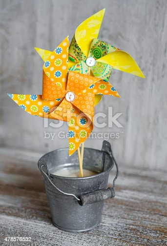 istock homemade paper pinwheel in vintage metal bucket 478576532