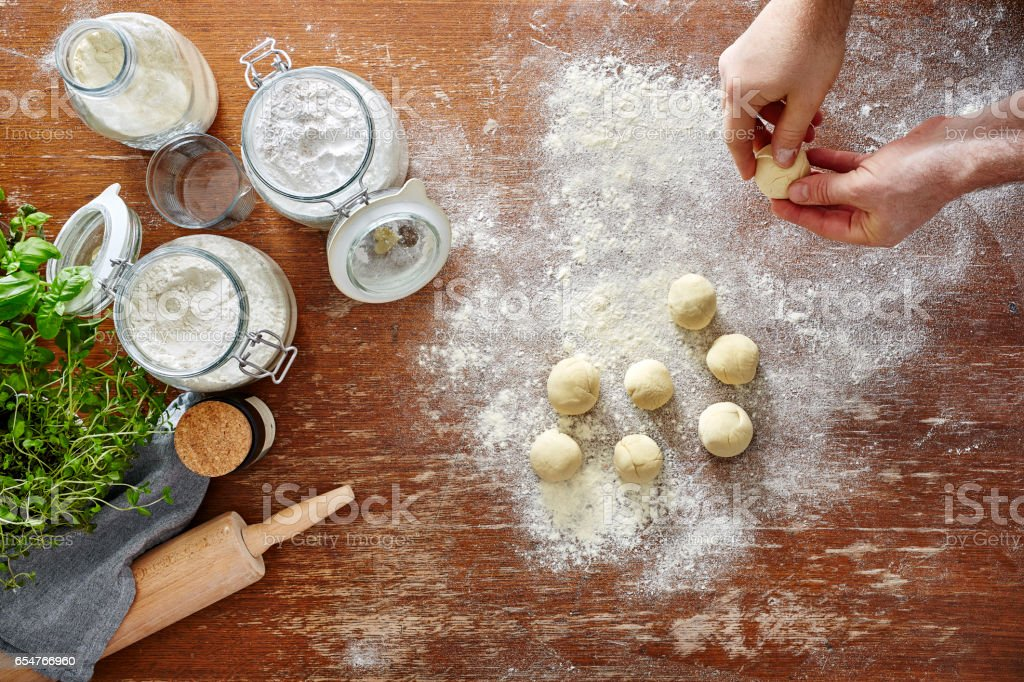 homemade pasta baking in kitchen hands forming dough stock photo