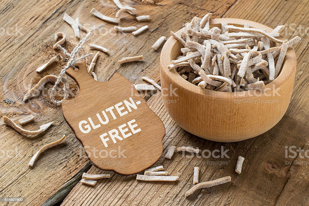 Homemade pasta from amaranth flour in a wooden bowl stock photo