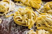 istock Homemade pasta on a wooden background. Italian style cuisine. Restaurant. 1206646318