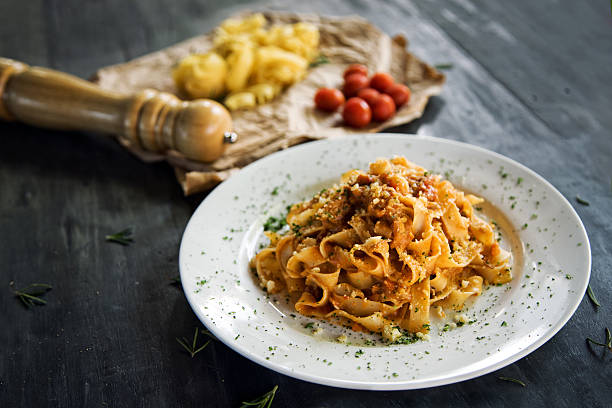 Homemade pasta Homemade fettucine pasta with bolognese sause tagliatelle stock pictures, royalty-free photos & images