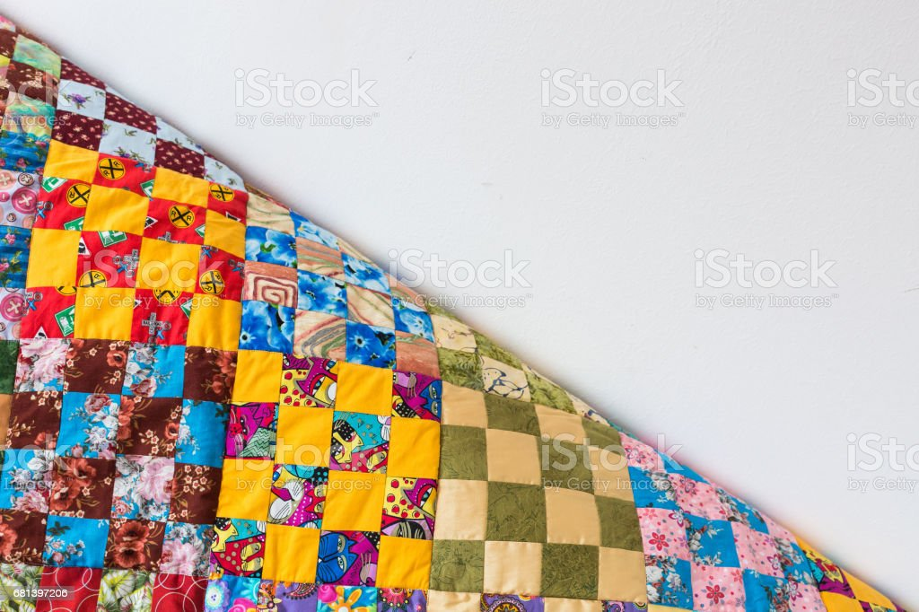 homemade, patchwork, quilting, sewing, comfort concept - multicolored handmaded blanket in best russian traditions made of textile squares with floral and abstract prints. with empty space for text royalty-free stock photo