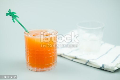 Homemade peach mix soda with ice cubes in glass