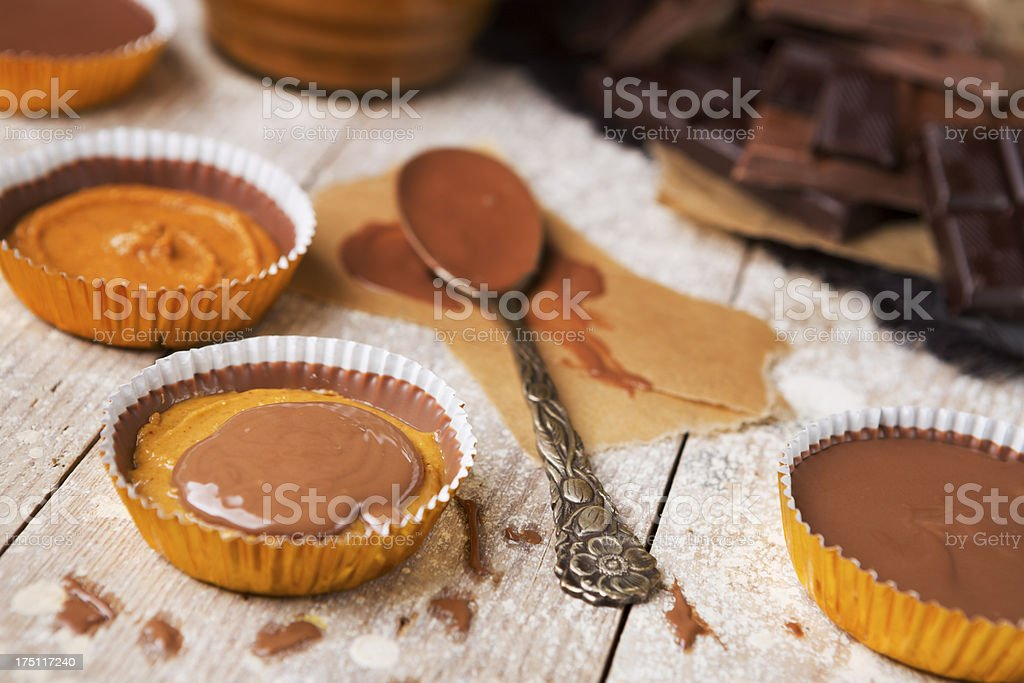 Homemade peanut butter cups on a rustic table royalty-free stock photo