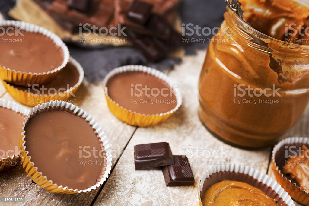 Homemade peanut butter cups on a rustic table stock photo