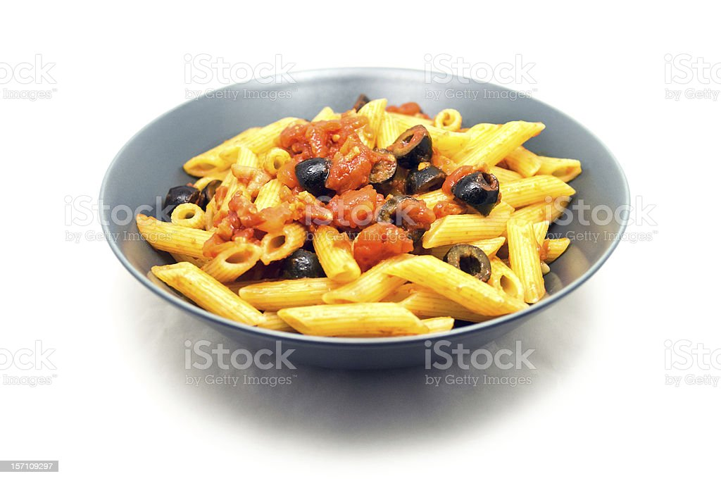 """Homemade Penne pasta a la """"puttanesca"""" on blue plate royalty-free stock photo"""