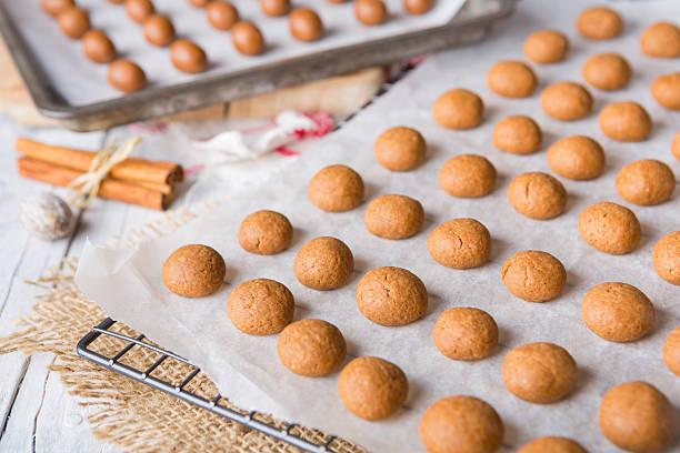 homemade pepernoten or kruidnoten for dutch holiday sinterklaas - kruidnoten stockfoto's en -beelden