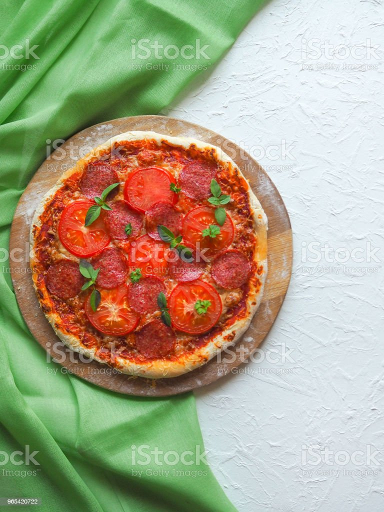 Homemade pepperoni pizza on a white kitchen table. royalty-free stock photo