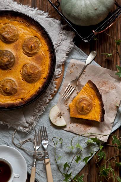 homemade pie cooked from apples and pumpkin on rustic wooden background. - pumpkin pie стоковые фото и изображения