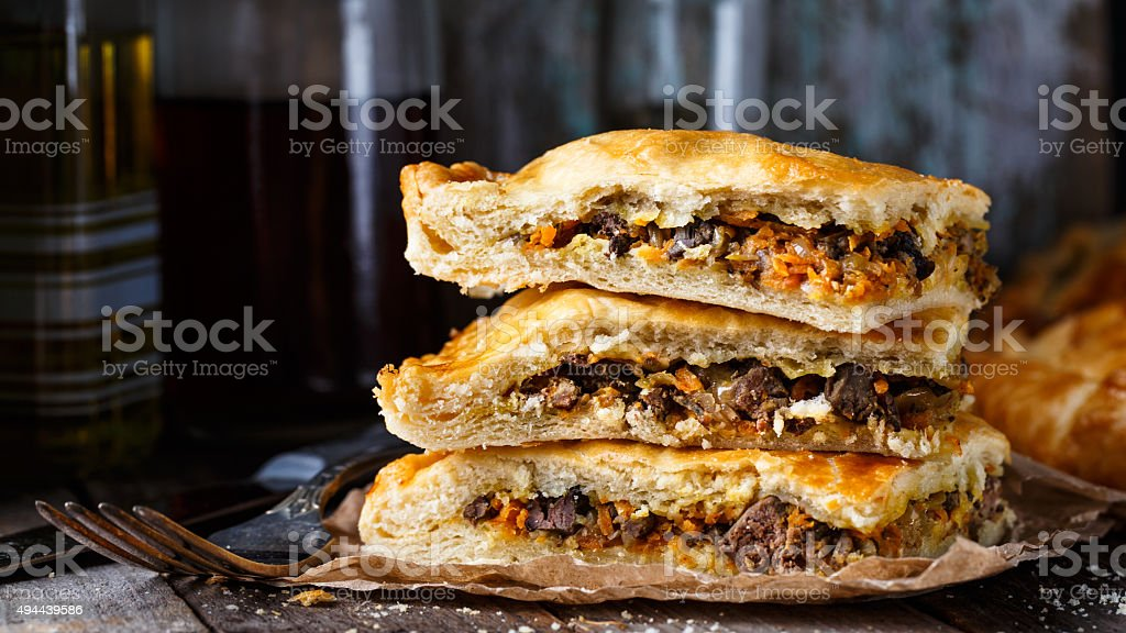 Homemade pie stuffed with liver stock photo