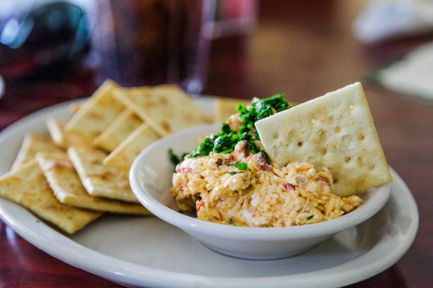 homemade pimento cheese and crackers - pimento cheese stock photos and pictures
